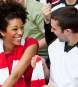 boy and girl at football match