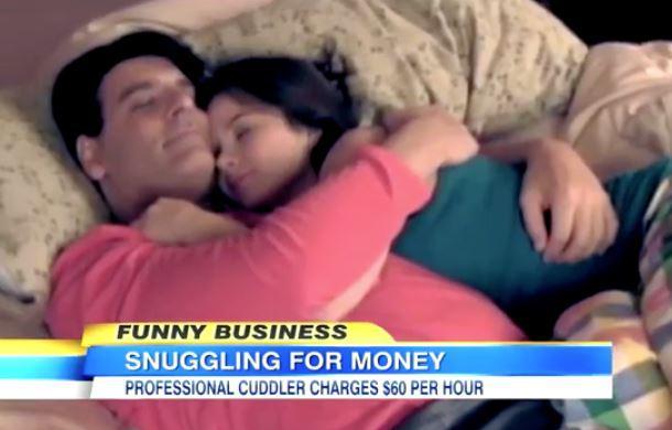 professional snuggler in bed