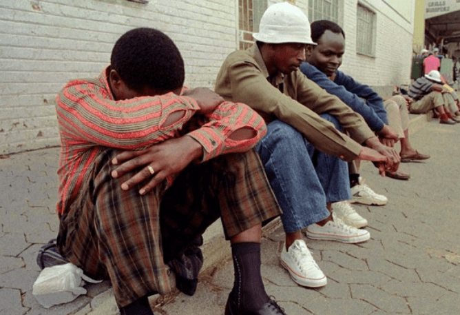 south african Jobless people sitting on pavement