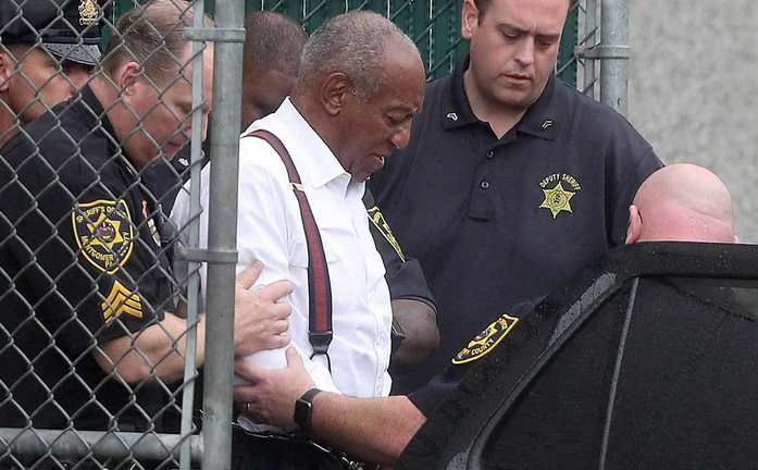 Bill cosby being escorted in police car