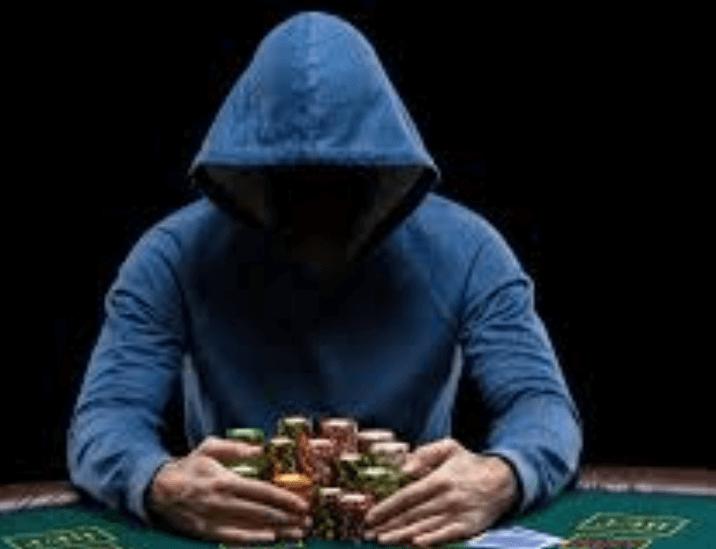 man winning tri-card poker