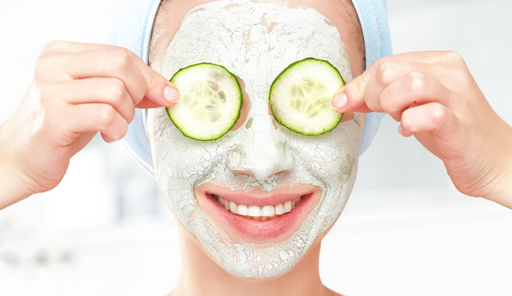 The image shows a lady doing a facial routine