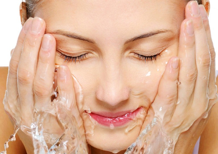 the image shows a lady washing your face